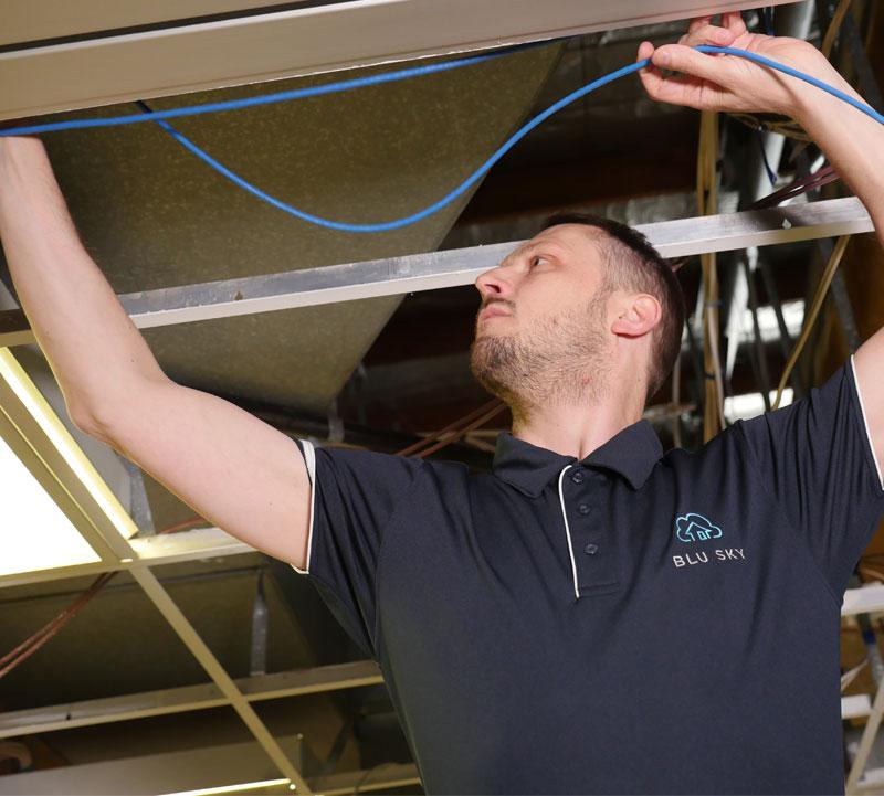 man installing data cabling network